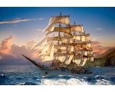Barca a vela al calar del sole